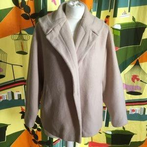 Vintage 1950s cream-colored swing jacket